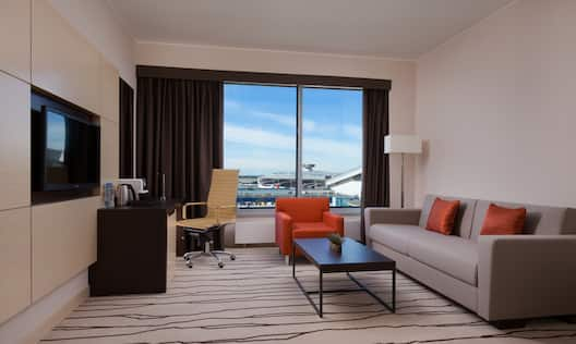 Suite Living Area with Airport View