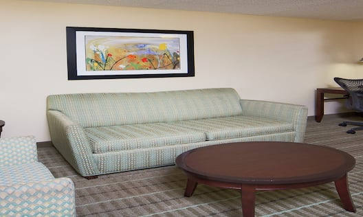 Guest Junior Suite Lounge Area with Sofa and Work Desk