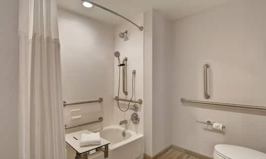 guest bathroom with accessible tub