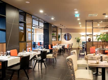 Restaurant area with tables and chairs