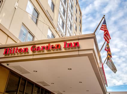 Hilton Garden Inn Hotel Exterior with Flags
