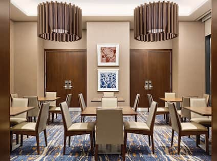 Dining Tables and Chairs in Lodge AreaPrivate Four-Person Dining Areas at our Capitol Riverfront Hotel