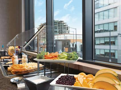 Wine, Cheese, Vegetable and Fruit Selections by Window at Evening SocialHealthy Options like Fresh Fruit, Yogurt and Granola at our Complimentary Breakfast Buffet