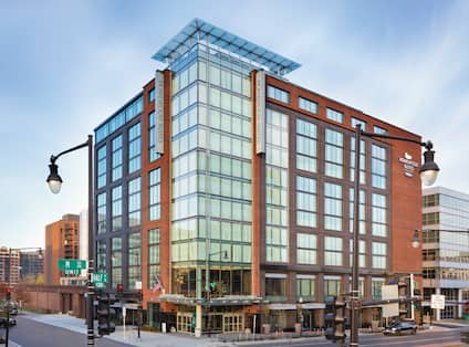 Daytime View of Hotel Exterior, Signage, Flagpole, and Street SignsHomewood Suites Washington DC Capitol Navy Yard Exterior
