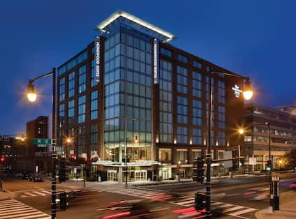Hotel Exterior, Signage, Flagpole, and Street Signs Illuminated at NightExterior of Homewood Suites by Hilton Washington Navy Yard Hotel