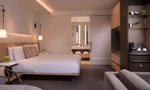 Studio Suite Guestroom with Bed, Room Technology, Mirror, and Vanity