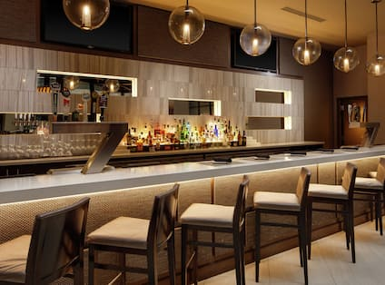 Tap Twelve Bar with Counter and Chairs