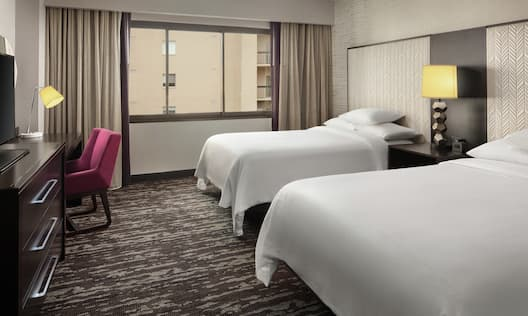 Guestroom with Double Double Beds, Room Technology, and Work Desk