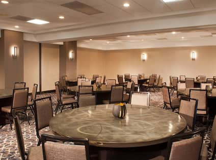 Meeting room with round tables and chairs