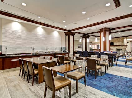 Buffet Selection in Lodge Area With Table and Chair Seating