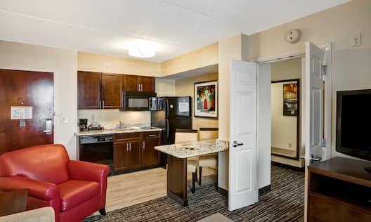 Living Room,  Door Entry, Kitchen, Dining Area, and Doors Opening to Bedroom