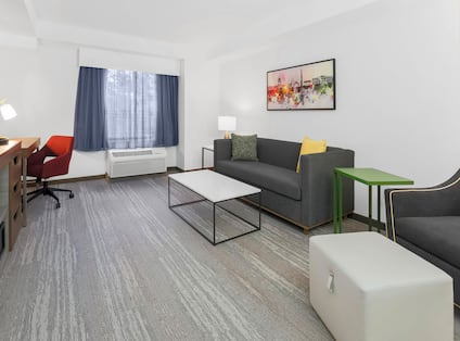 Guestroom Living Area with Sofa and Work Desk