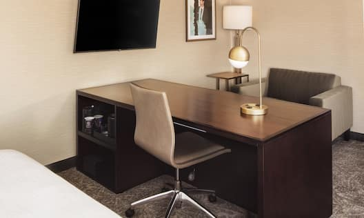 Guestroom with Work Desk, Lounge Chair and Television