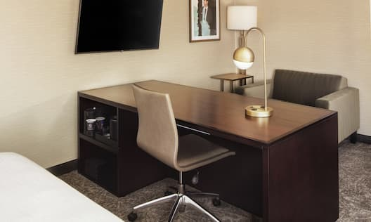 Suite Living Room With Desk and TV