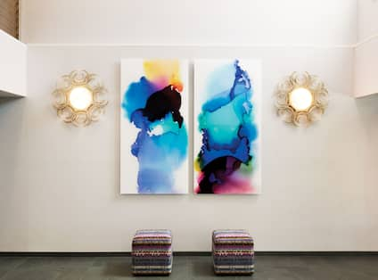 Large art display on wall in lobby