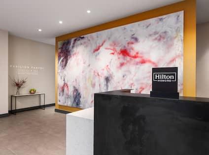 Hotel Front Desk with Modern Art Backdrop