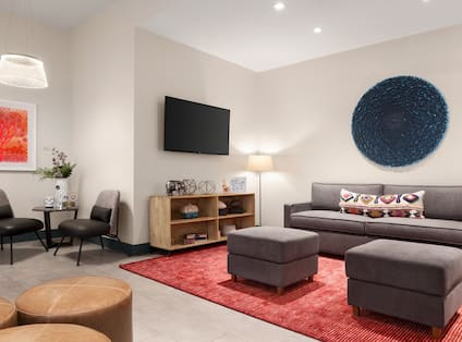 Lobby Seating Area with Sofa, Couches, TVs, and Decor