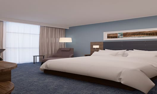 King Guestroom with Bed, Lounge Area, Work Desk, and Room Technology