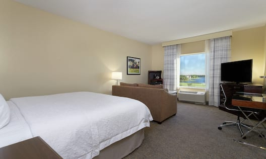King Deluxe Room with Sofa, Work Desk, and TV