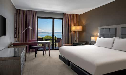 Executive Bedroom with Work Desk and Lake View