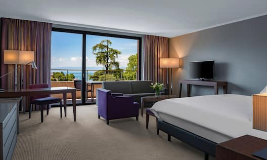 Junior Suite Bedroom with Desk and Lake View