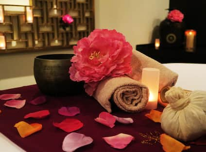 Flower Petals and Candle in Spa Treatment Room