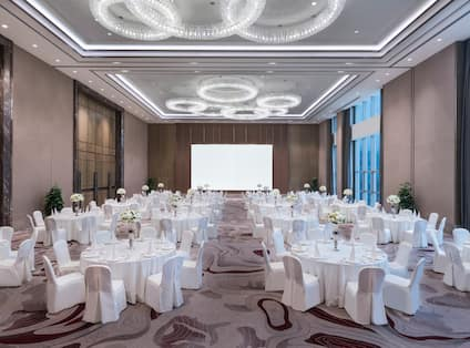 Ballroom with White Round Tables