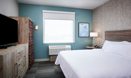 1 King Bed 1 Bedroom Suite Sleeping Area