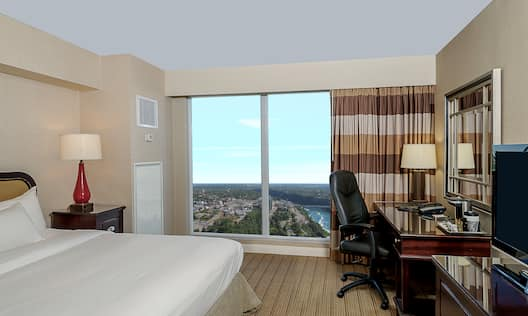 Guest Room with King Bed, Work Desk, and Scenic View