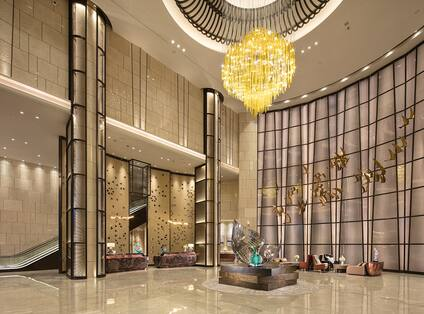 Lobby with Chandelier and Wall Decor