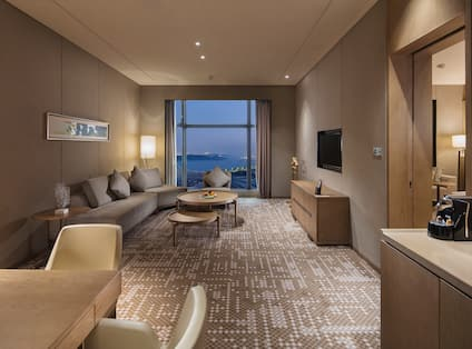 Premium Suite Lounge Area with Sofa, Coffee Table and Wall Mounted HDTV