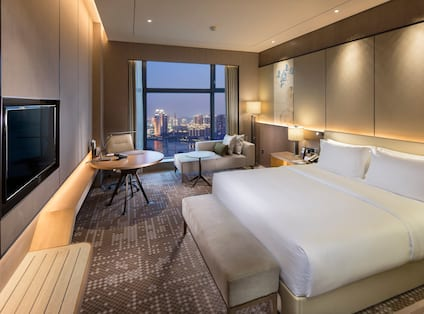 King-Sized Bed, Work Desk and Chaise Lounge by Large Window
