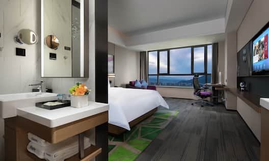King Superior Room with TV, work desk, lounging area and outside views