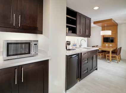 Guest Suite Kitchen with Amenities and Dining Table