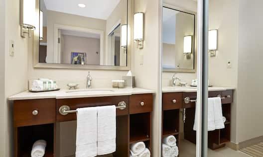 Large Vanity Mirror, Sink, Towels, Toiletries, With Mirrored Doorway