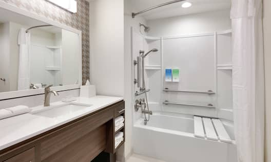 Bathroom with tub and sink