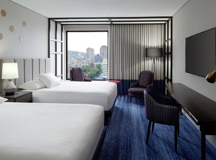 Two Queens City View Guest Room