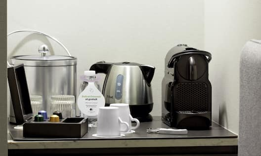 Close-Up of Guestroom Coffee Machine and Kettle