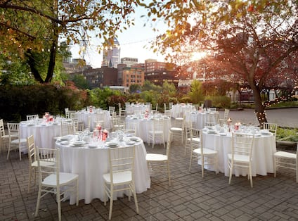 an outdoor wedding reception seating area