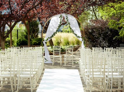 an outdoor wedding ceremony seating area