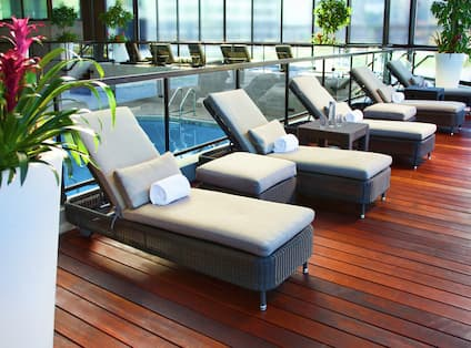 Lounge Chairs in Front of Indoor Pool