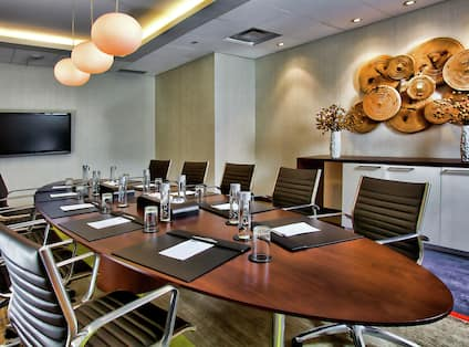 Petit Salon A with Boardroom Seating and TV