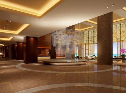 Spacious Lobby With Soft Seating and View of Front Desk and Window in Background