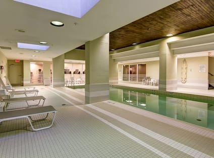 Indoor Swimming Pool with Deck Chairs