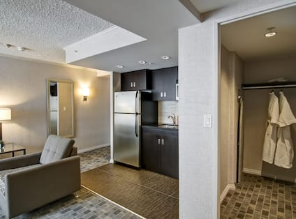 Guestroom Lounge and kitchen Area with Wardrobe Closet