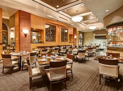 Spacious Restaurant Dining Area with Seats and Tables