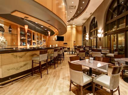 Bar Lounge Area with Seats and Tables at Night
