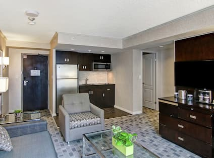 Living Room and Wet Bar Area of 2 Room Deluxe Suite