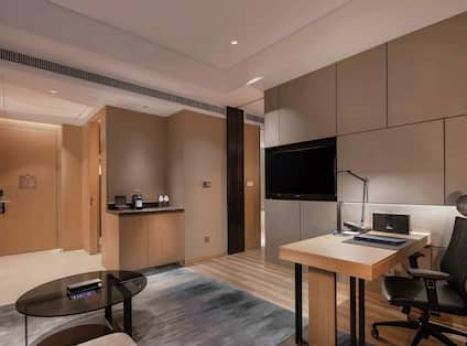 Suite Living Room with Wet Bar, Work Desk and Television