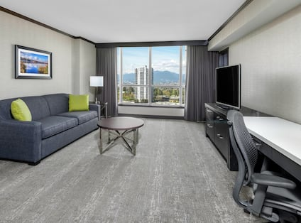 This suite features a living area with a queen-sized sofa bed.